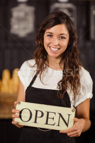 Portrait of a waitress showing open sign  Stock photo © wavebreak_media