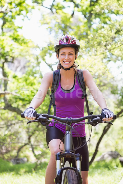 Gülümseyen kadın bisiklete binme kadın mutlu doğa Stok fotoğraf © wavebreak_media