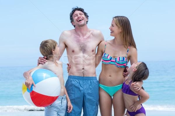 Family in swimwear standing at sea shore Stock photo © wavebreak_media