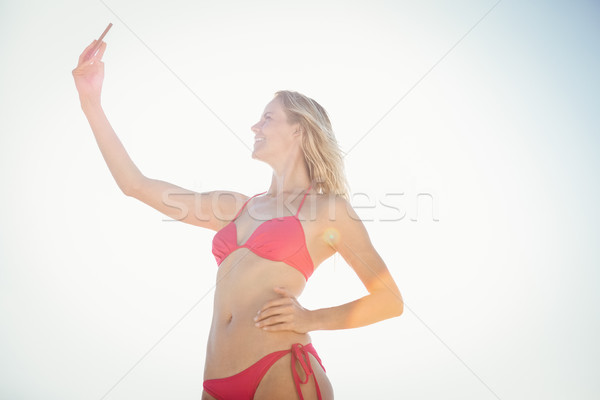 Blonde woman taking a selfie Stock photo © wavebreak_media