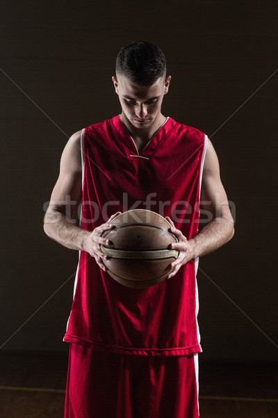 Portrait of basketball player holding a ball Stock photo © wavebreak_media