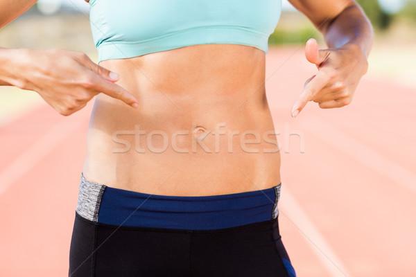 Középső rész női atléta mutat has fut Stock fotó © wavebreak_media