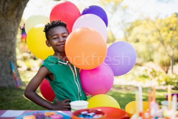 Cute ragazzo sorridere posa pallone compleanno Foto d'archivio © wavebreak_media