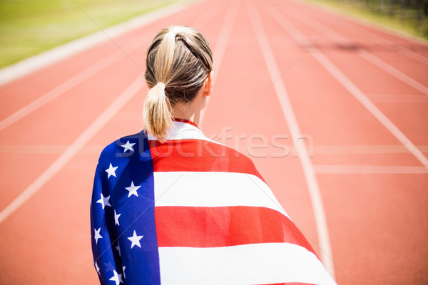 Rear view of female athlete wrapped in american flag Stock photo © wavebreak_media