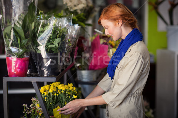 Female florist arranging flower bouquet Stock photo © wavebreak_media