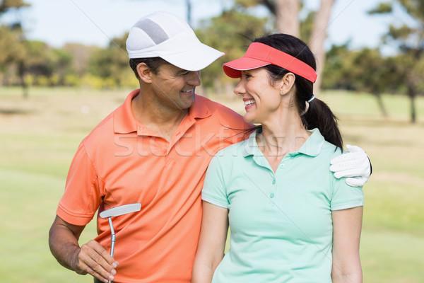 улыбаясь гольфист пару руки вокруг Постоянный Сток-фото © wavebreak_media