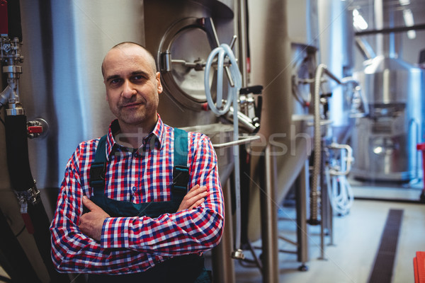Manufacturer with arms crossed standing at brewery Stock photo © wavebreak_media
