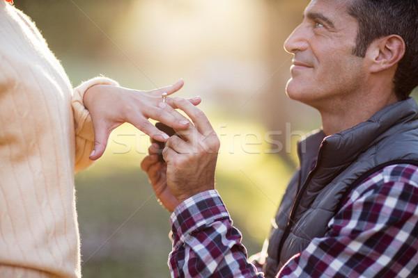 Smiling man putting ring in woman hand Stock photo © wavebreak_media