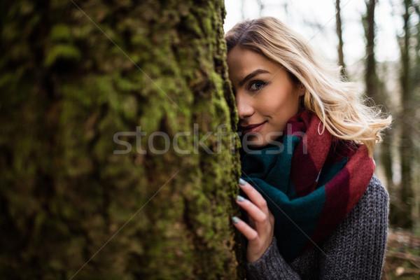 Güzel bir kadın gizleme arkasında orman portre Stok fotoğraf © wavebreak_media