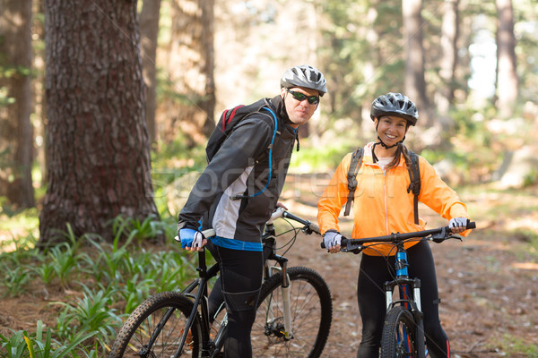 Biker couple standing with mountain bike on dirt track Stock photo © wavebreak_media