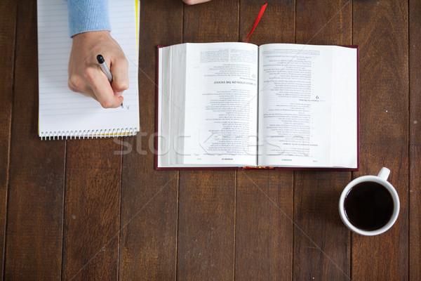 Adam İncil yazı notepad oturma büro Stok fotoğraf © wavebreak_media