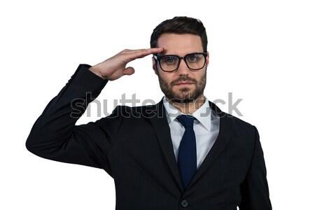 Businessman saluting against white background Stock photo © wavebreak_media