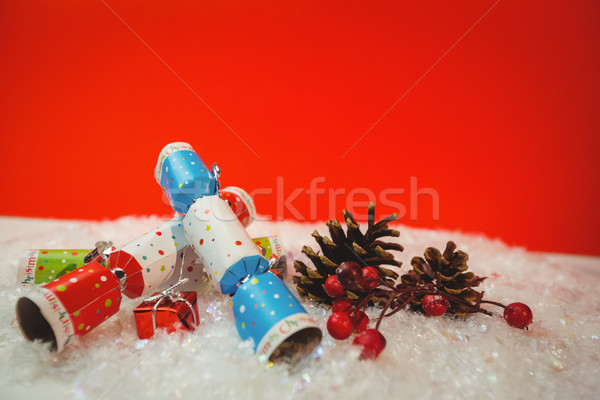 Christmas crackers and christmas decoration on snow Stock photo © wavebreak_media