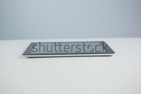 Közelkép digitális tabletta fehér üveg asztal Stock fotó © wavebreak_media