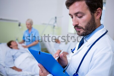 Portrait of doctor standing with arms crossed Stock photo © wavebreak_media