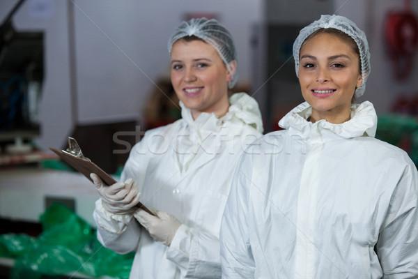 Female butchers holding clipboard Stock photo © wavebreak_media