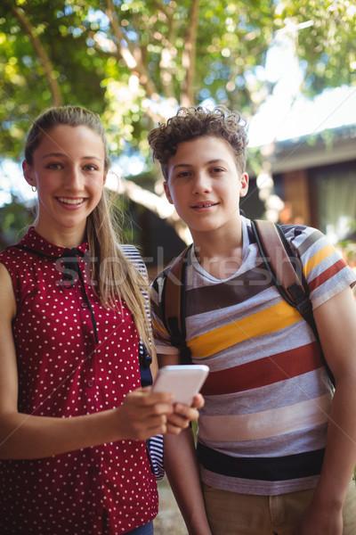 Portrait heureux téléphone portable école campus Photo stock © wavebreak_media