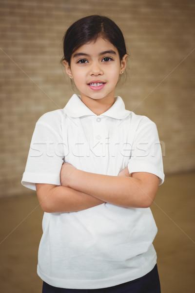 Feliz dobrado brasão criança retrato sala de aula Foto stock © wavebreak_media