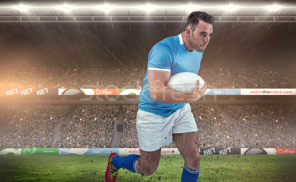Composite image of rugby player running with the ball Stock photo © wavebreak_media