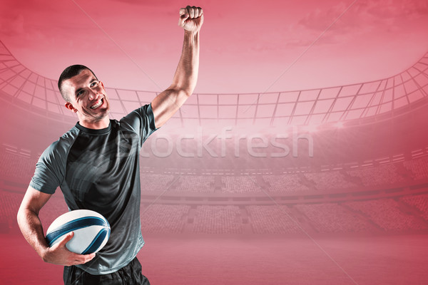 Composite image of happy rugby player punching the air Stock photo © wavebreak_media