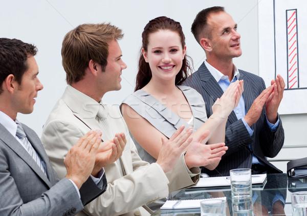 Attractive businesswoman applauding in a meeting Stock photo © wavebreak_media