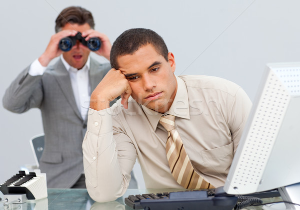 Angry businessman annoyed by a man looking through binoculars Stock photo © wavebreak_media