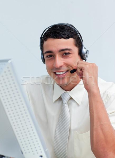 Assertive businessman talking on headset  Stock photo © wavebreak_media