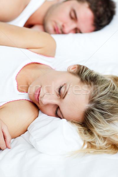 Bella donna dormire fidanzato letto ragazza amore Foto d'archivio © wavebreak_media