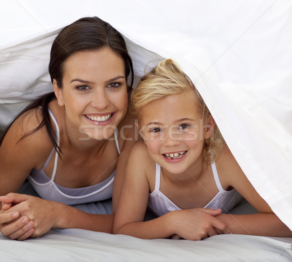 Mother and daughter under the bedsheets Stock photo © wavebreak_media