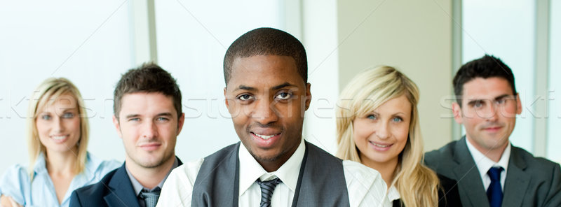 Business team in a row with ethnic manager in the center Stock photo © wavebreak_media