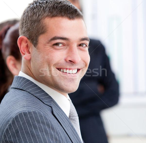Közelkép mosolyog üzletember bemutató csapat munka Stock fotó © wavebreak_media