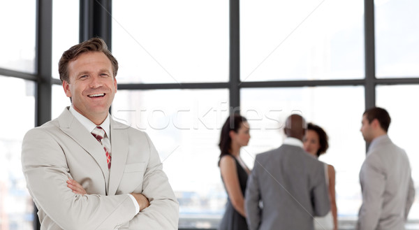 Joyful male manager leading his team in a office Stock photo © wavebreak_media