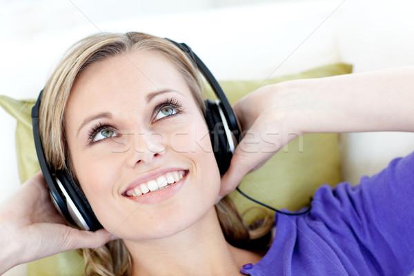 Joyful woman  listening to music in the living-room Stock photo © wavebreak_media