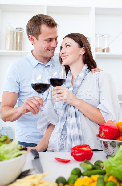 Affectionate couple drinking wine while cooking in the kitchen Stock photo © wavebreak_media