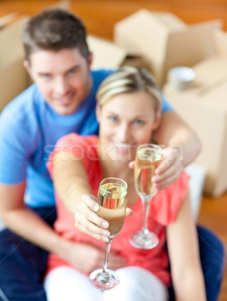 Fiatal pér ül padló ünnepel eltávolítás pezsgő Stock fotó © wavebreak_media
