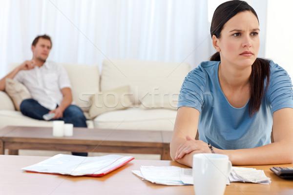 сердиться женщину счет дружок расслабляющая диван Сток-фото © wavebreak_media