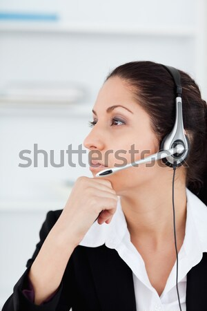Pretty representative on the phone with earpiece in the office Stock photo © wavebreak_media