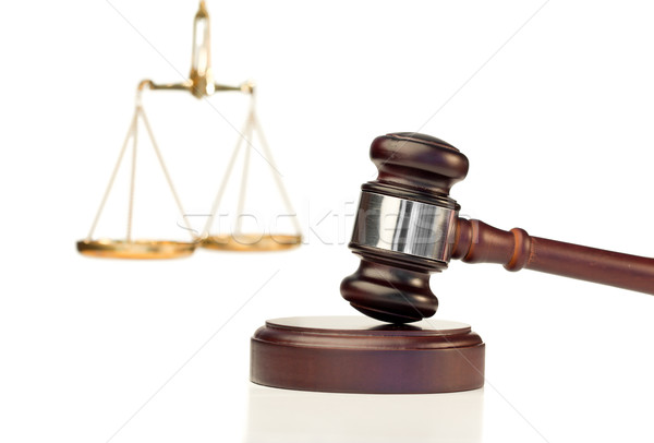 Gavel in action and scale of justice on a white background Stock photo © wavebreak_media