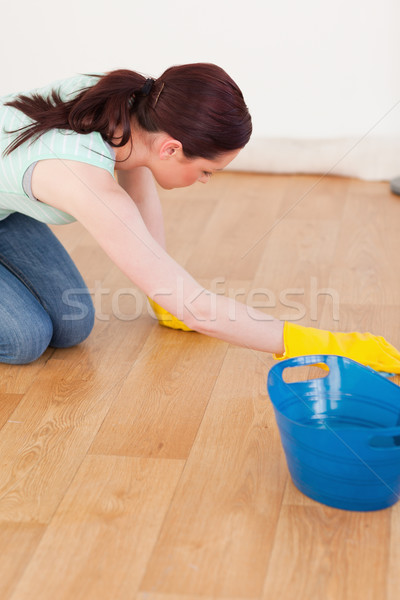 Beautiful red-haired female using a saw for diy at home Stock photo © wavebreak_media