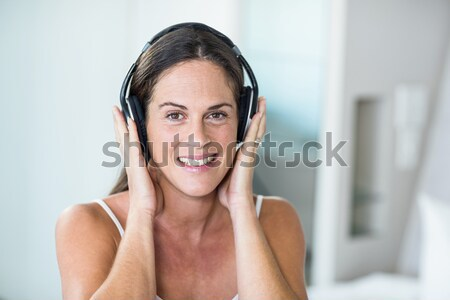 Close up of a lovely woman enjoying some music while looking at the camera Stock photo © wavebreak_media