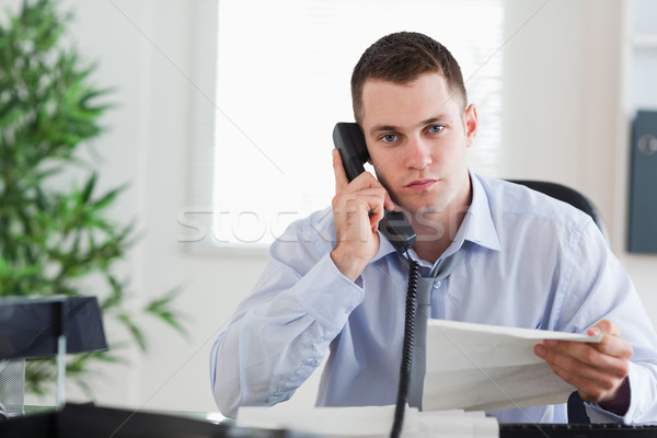 Young businessman on the phone with the author of a letter Stock photo © wavebreak_media
