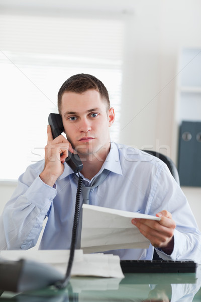 Close up of young businessman calling the author of a letter Stock photo © wavebreak_media