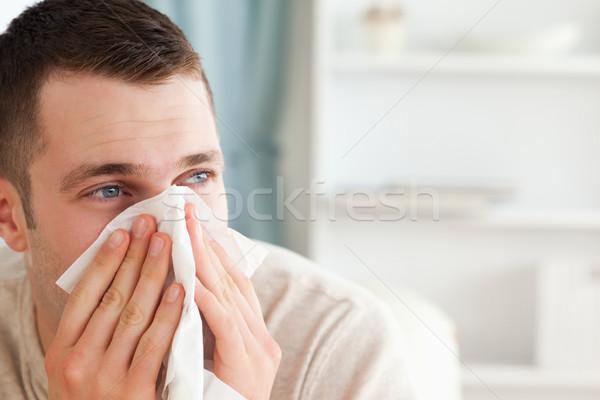Malade homme moucher salon santé canapé Photo stock © wavebreak_media