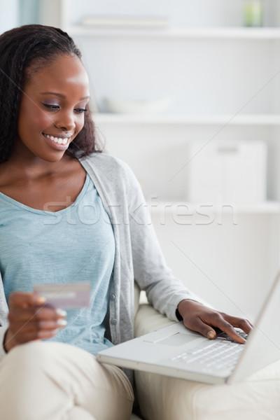 close up of smiling woman shopping online stock photo wavebreak media ltd wavebreak media. Black Bedroom Furniture Sets. Home Design Ideas