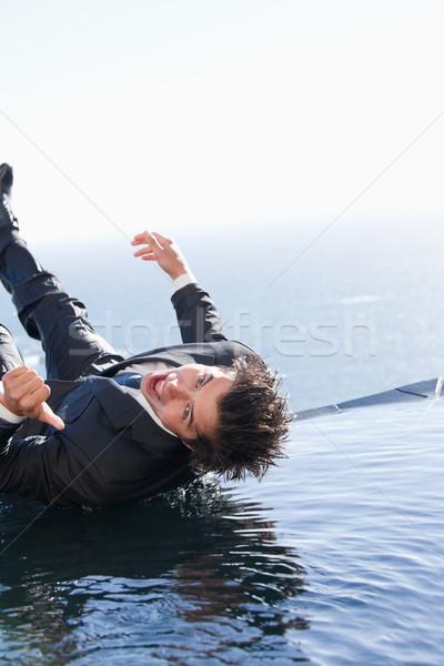 Foto stock: Retrato · empresário · queda · água · polegar · para · cima