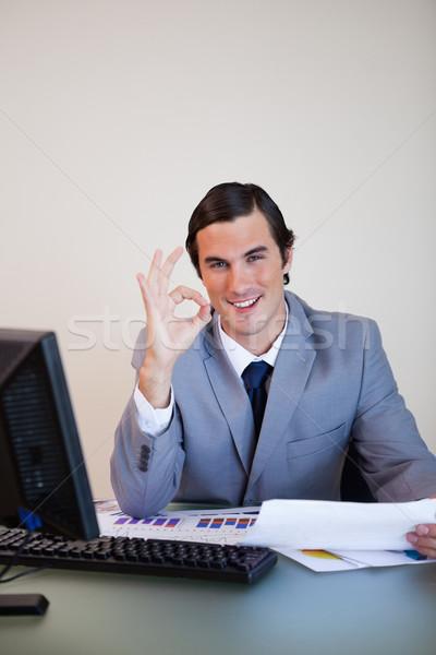 Smiling businessman approving paperwork Stock photo © wavebreak_media