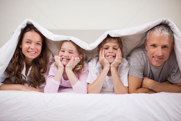 семьи спальня улыбка любви домой Сток-фото © wavebreak_media