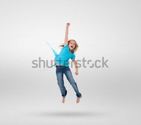 Gelukkig jonge vrouw springen lucht witte Stockfoto © wavebreak_media
