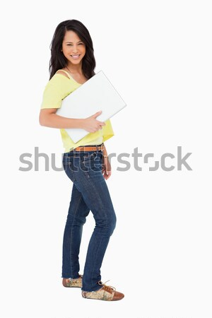 Latin student showing a touch pad screen against white background Stock photo © wavebreak_media