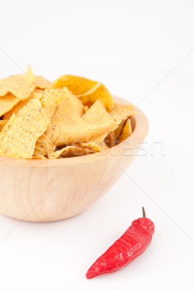 Pimento near a full bowl of crisps  against white background Stock photo © wavebreak_media